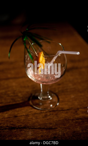 empty cocktail glass with crushed ice, straw and sparkler - Stock Image