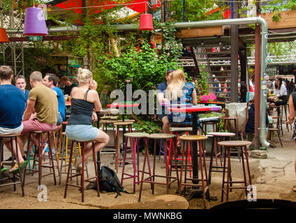 The garden of Szimpla Kert , one of the oldest Ruin Pubs In Budapest - Stock Image