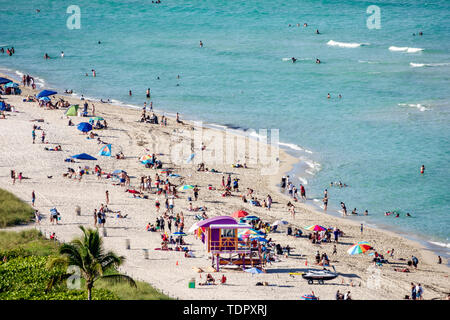 Miami Beach Florida North Beach North Shore Open Space Park Atlantic Ocean sunbathers public beach sand umbrellas shoreline lifeguard tower station cr - Stock Image