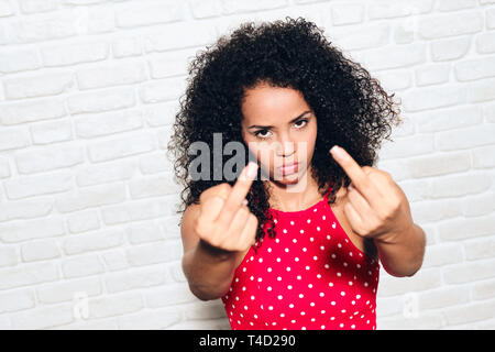 Angry Woman Showing Middle Finger For Fight Argument - Stock Image