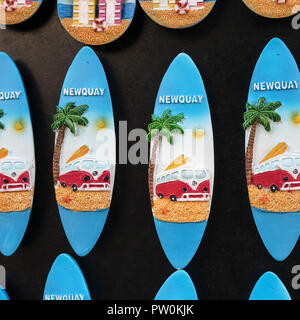 Small surfboard fridge magnet souvenirs on sale at a Newquay souvenir shop - home of Boardmasters Festival. - Stock Image