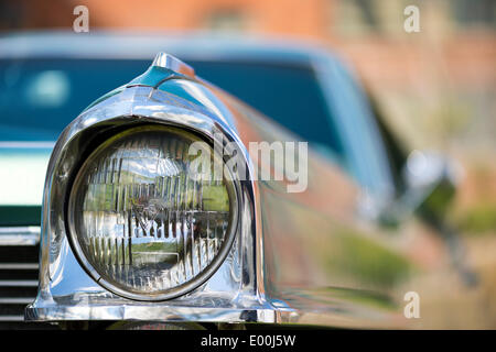 Floral Park, New York, U.S. - April 27, 2014 -  A headlight detail of a 1965 Cadillac Calais luxury classic car exhibited at the 35th Annual Antique Auto Show at Queens Farm. - Stock Image