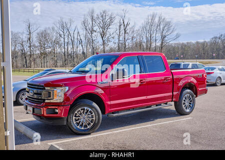 New red 2019 Ford F150 fully loaded quad cab pick up truck parked at an country market in rural Alabama, USA. - Stock Image