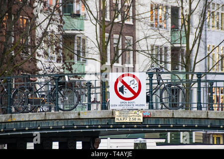 Sign on a bridge advising amplified music not allowed, Amsterdam, The Netherlands - Stock Image