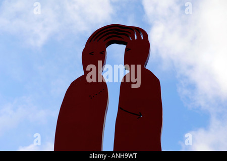 red unity together sculpture modern art rinteln germany deutschland travel tourism concept love close attached bond - Stock Image