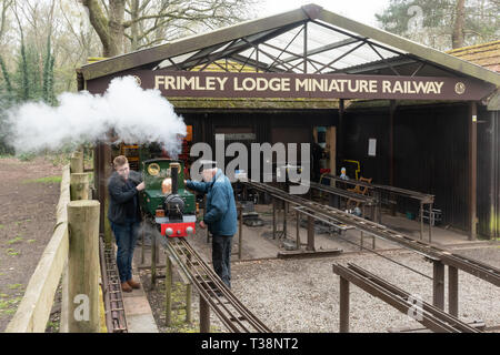 Miniature steam train and railway at Frimley Lodge Park, Frimley, Surrey, UK - Stock Image