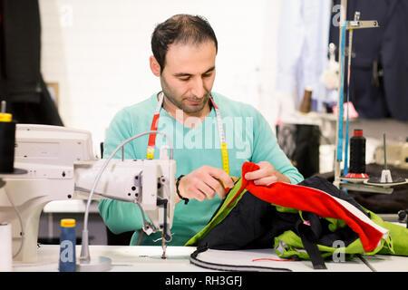 Tailor in studio - Stock Image