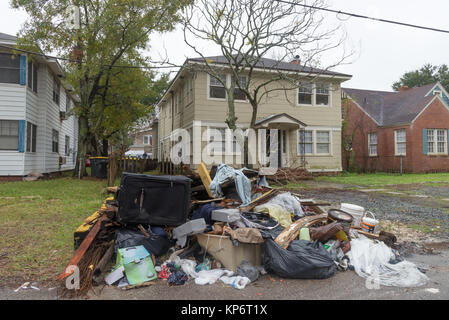 Piles of debris still sit alongside the road in the aftermath of Hurricane Irma December 5, 2017 in Jacksonville, - Stock Image