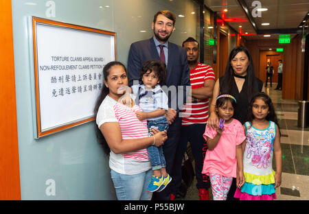 Hong Kong, Hong Kong, China. 25th June, 2018. Supporters and fellow Snowden refugees attend Ajith's torture claim appeal session along with Canadian refugee and human rights Barrister and solicitor Guillaume Cliche-Rivard (L rear).L Nadeeka Dilrukshi Nonis holding her son Dinath (daughter Sethumdi R), rear middle, Supun Thilina Kellapatha and right, Vanessa mae Rodel with her daughter Keana in front (pink).Torture Claim Appeals board North Point Hong Kong Credit: Jayne Russell/ZUMA Wire/Alamy Live News - Stock Image