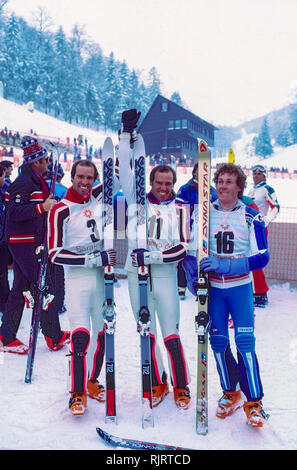Phil Mahre (USA) Gold -C-, Steve Mahre (USA) Silver, Didier Bouvet (FRA) Bronze, winners of the Men's Slalom at the 1984 Olympic Winter Games. - Stock Image