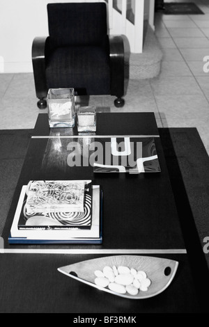 Books on a table in a living room - Stock Image