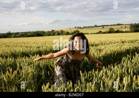 Chinese Girl in a Corn Field - Stock Image