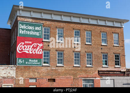 JOHNSON CITY, TN, USA-9/30/18: A refreshed version of an old Coca-cola sign is displayed on the side of an old brick building in downtown. - Stock Image