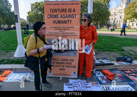 London, UK. 10th October 2018. The Guantanamo Justice Campaign hold another monthly vigil opposite Parliament calling on UK Prime Minister Theresa May to make urgent representations to President Trump to close Guantanamo and end the brutality and torture which is continuing against the 40 men still held there in indefinite detention. They call on Trump to respect human rights and international law, stating that the illegal camp is a legal and moral outrage and a symbol of US torture and injustice. Credit: Peter Marshall/Alamy Live News - Stock Image