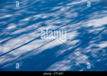 Snowmobile trail on snow - Stock Image
