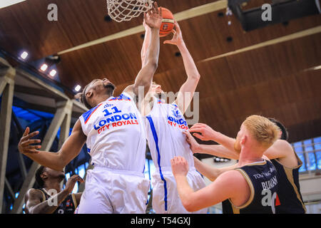 London, UK, 20th April 2019. Royals' Matthew Bryan-Amaning (11) and Will Neighbour (15) finish a point under the basket. Tensions run high in the London City Royals v Glasgow Rocks BBL Championship game at Crystal Palace Sports Centre. Home team LCR win the tight game 78-70. Credit: Imageplotter/Alamy Live News - Stock Image