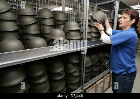 (dpa) - Helmets in different sizes lay at hand for fitting in the armoury for recruted conscripts pictured at the - Stock Image