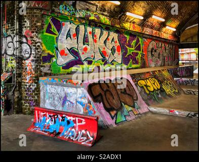 Colourful & Creative Graffiti in a Skateboarding Area. Youth Culture at its best! Photo Credit - © COLIN HOSKINS. - Stock Image