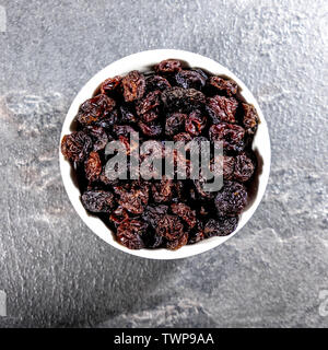 Looking Down On A Bowl of Healthy Dried Raisins Fruit - Stock Image