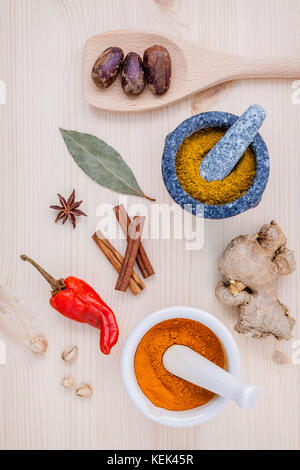 Dried herbs and spices nutmeg,star anise ,cinnamon stick ,ginger ,bay leave and chili on wooden table. Top view - Stock Image