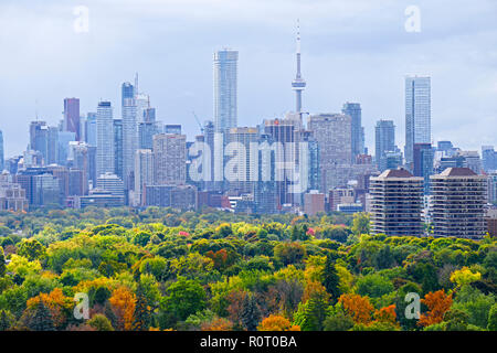 Toronto downtown and midtown skyline with autumn leaf colors in front of landmark skyscrapers under cloudy sky on October 17, 2018 - Stock Image