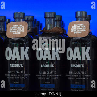 Absolut Vodka Oak.  Bottles on display against a blue illuminated background. - Stock Image