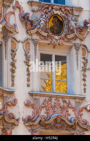 GOLDEN ROOF BUILDING REFLECTING IN THE FRONT OF HELBINGHAUS BUILDING, BAROQUE STYLE, OLD TOWN, INNSBRUCK, TYROL, - Stock Image