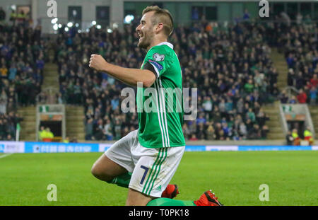 National Football Stadium at Windsor Park, Belfast, Northern Ireland. 21 March 2019. UEFA EURO 2020 Qualifier- Northern Ireland v Estonia. Action from tonight's game. Delight for Niall McGinn after he opened the scoring for Northern Ireland. His fourth goal for Northern Ireland but the first at home. Credit: David Hunter/Alamy Live News. - Stock Image