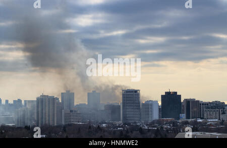 Toronto, Canada. 14th Feb, 2017. Massive smoke in the sky after 6-alarm fire broke out from Badminton & Racquet - Stock Image
