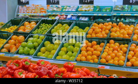 Fresh fruits and vegetables at grocery store - Stock Image