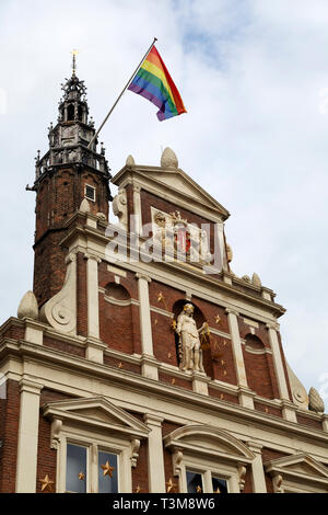 The rainbow flag of the LBGTQ Movement flies above the city hall in Haarlem, the Netherlands. It flies on National Coming Out Day (11 October). - Stock Image