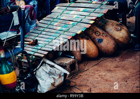 Xylophone and various instrument ready for performance. Multi Ethnic music party to celebrate western and developing countries cooperation. Bamako, Ma - Stock Image