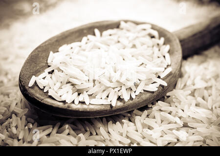 A Wooden Kitchen Spoon On A Pile Of Rice, Monochrome Colors - Stock Image