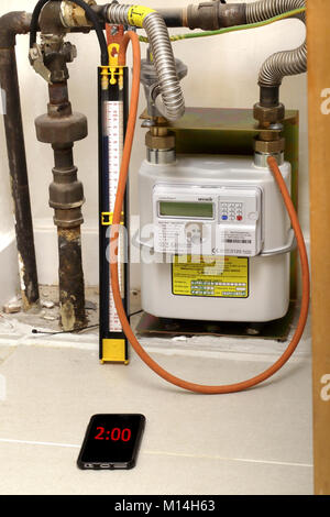 A newly installed gas 'smart meter' being pressure and leak tested. - Stock Image
