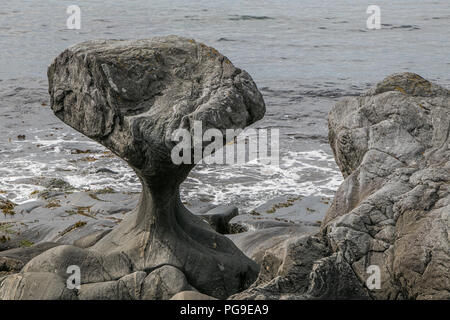 Famous Kannesteinen - a coastal rock with a very characteristic shape, located near Maloy, Norway. - Stock Image