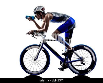 man triathlon iron man athlete biker cyclist bicycling biking drinking in silhouette on white background - Stock Image