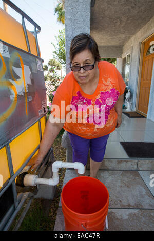 A woman at a house in Porterville, California which has had no running water for five months as a result of the - Stock Image