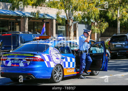 Australian police officer in Highway Patrol police car at an ANZAC Day march in Sydney,Australia - Stock Image