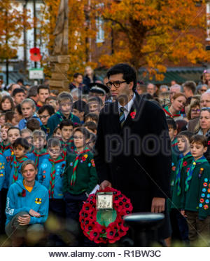 Fleet, Hampshire, UK. 11th November 2018. Ranil Jayawardena MP for North East Hampshire prepares to lay a wreath at the town's war memorial during the  Armistice Day Act of Remembrance. Credit: Images by Russell/Alamy Live News - Stock Image