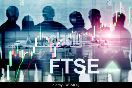 FTSE 100 Financial Times Stock Exchange Index United Kingdom UK England Investment Trading concept with chart and graphs. - Stock Image
