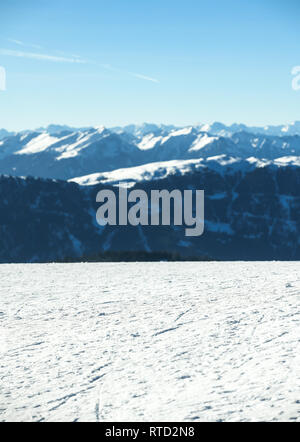Beautiful view on the snow capped  mountains with texture of ski trails and tracks at ski resort. Copy space for products placement or text. Plan de C - Stock Image