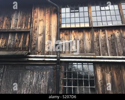 Old timber workshop with metal windows - Stock Image