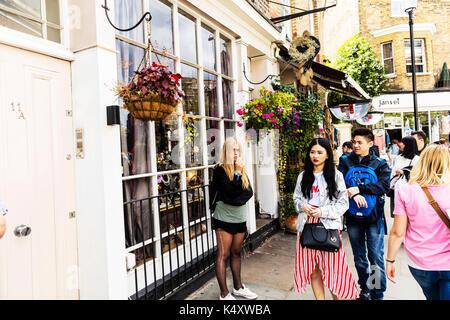 Ladder in tights, ring through nose, smoking, blonde smoking, blonde girl smoking, Portobello Road London, Portobello Road, Portobello Road people, UK - Stock Image