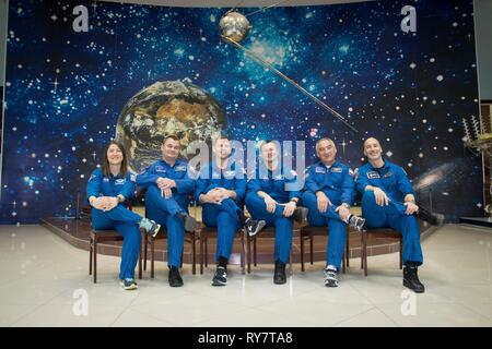 International Space Station Expedition 59 prime and backup crew members pose for a group photo at the Baikonur Cosmodrome March 12, 2019 in Baikonur, Kazakhstan. From left to right are the prime crew members: Christina Koch of NASA, Alexey Ovchinin of Roscosmos and Nick Hague of NASA, the backup crewmembers: Drew Morgan of NASA, Alexander Skvortsov of Roscosmos and Luca Parmitano of the European Space Agency. Expedition 59 crew will launch March 14th onboard the Soyuz MS-12 spacecraft for a six-and-a-half month mission on the International Space Station. - Stock Image