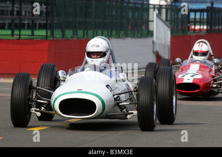 two classic racing cars at Silverstone race track - Stock Image