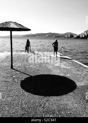 People preparing for morning swim - Stock Image