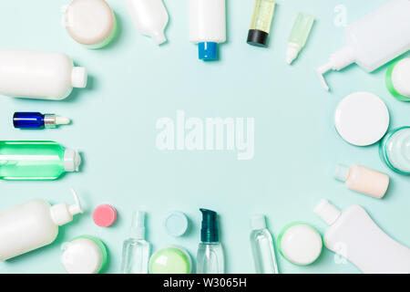 Frame of plastic bodycare bottle Flat lay composition with cosmetic products on blue background empty space for you design. Set of White Cosmetic cont - Stock Image
