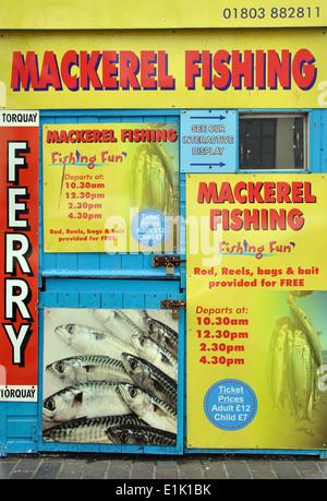 adverts on kiosk for mackerel fishing boat trips, Brixham, Devon, England, UK - Stock Image