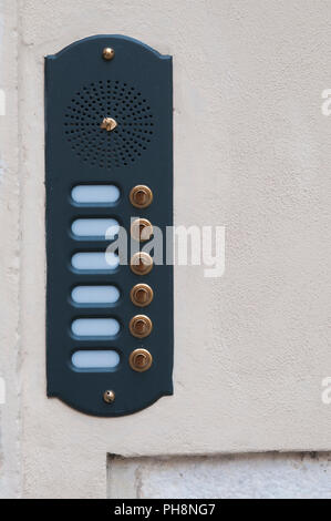 Doorbells with gold buttons and blank nameplates - Stock Image
