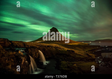 Kirkjufell, or 'Church Mountain', is a distinctly shaped peak found on the north shore of Iceland's Snæfellsnes Peninsula, only a short distance away  - Stock Image